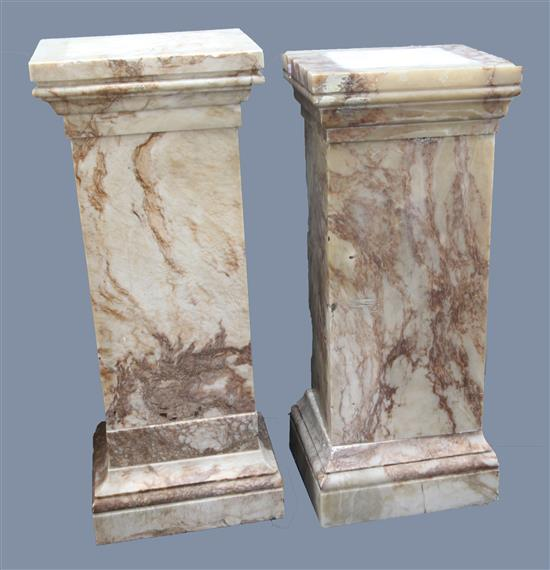A near pair of square section pink veined marble pedestals, W.1ft 6in. D.1ft 4in. H.3ft 8in.