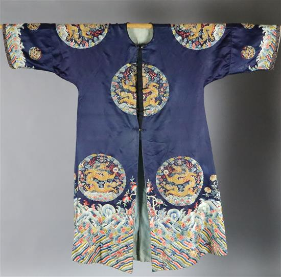 A Chinese noblewomans embroidered silk midnight blue surcoat (longgua), late 19th century, 138cm long, minor alterations to sleeves an