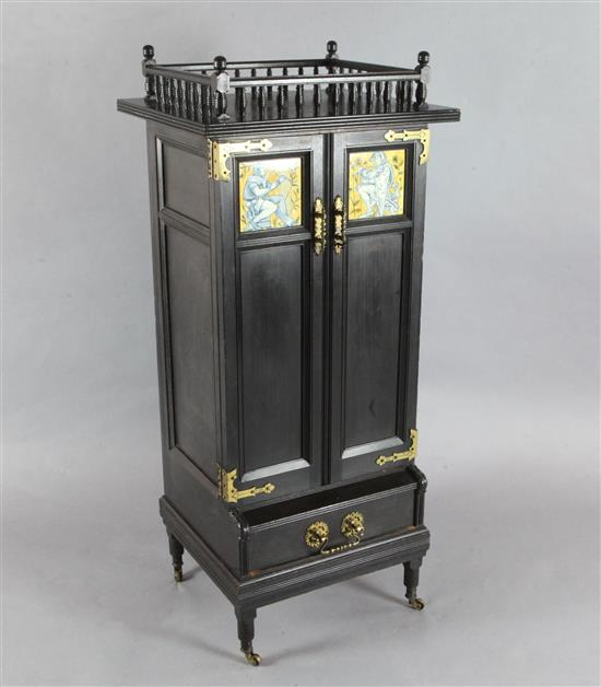 An Aesthetic movement ebonised music cabinet, in the manner of Morris & Co., W.30in.
