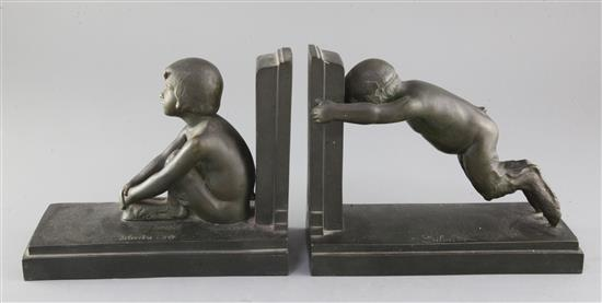 Paul Silvestre (French 1884-1976). A pair of early 20th century patinated bronze bookends, Susse Freres, Paris, length 8.25in.