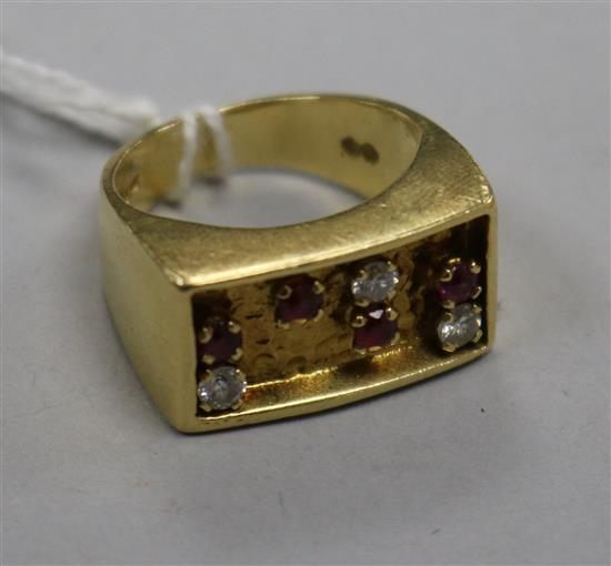 An early 1970s 18ct gold, ruby and diamond set ring, size K.
