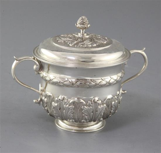 A George V 18th century style silver porringer and cover by Thomas of New Bond Street, 10 oz.