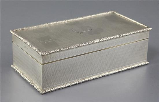 A George V engine turned silver rectangular cigarette box, retailed by Asprey & Co,