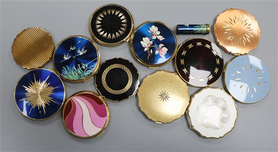 Twelve vintage Stratton powder compacts, including a blue enamelled flying ducks example with matching lipstick holder,
