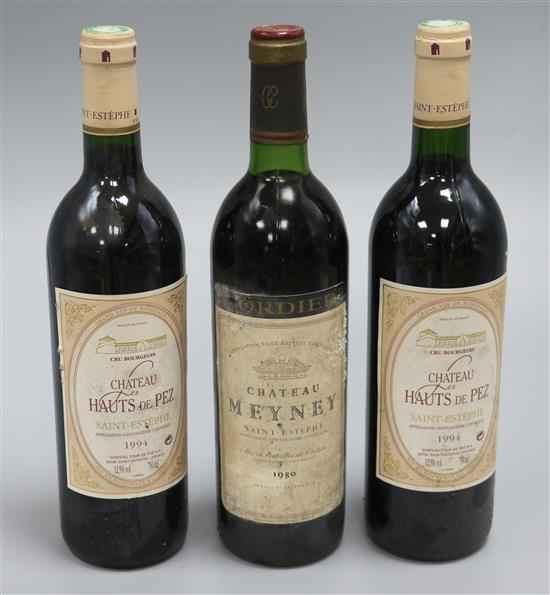 A bottle of Chateau Meyney, St. Estephe, 1980 and two bottles of Chateau Haut des Pez, St. Estephe, 1994