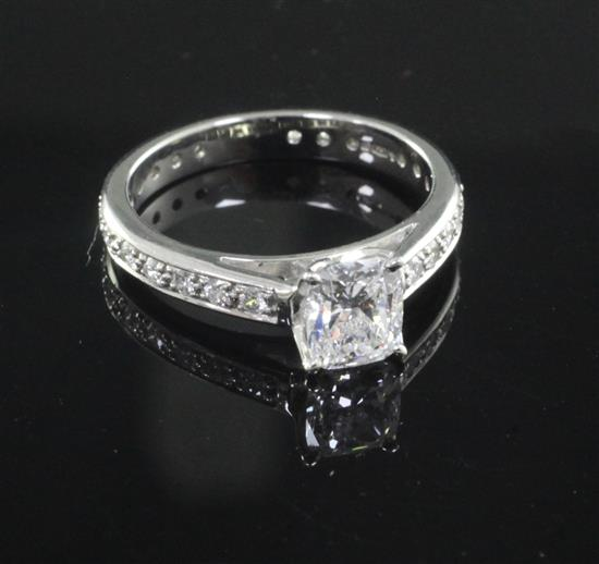 A modern platinum and single stone diamond ring with diamond set shank, size M.