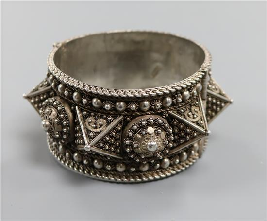 A large Lebanese white metal hinged bangle.