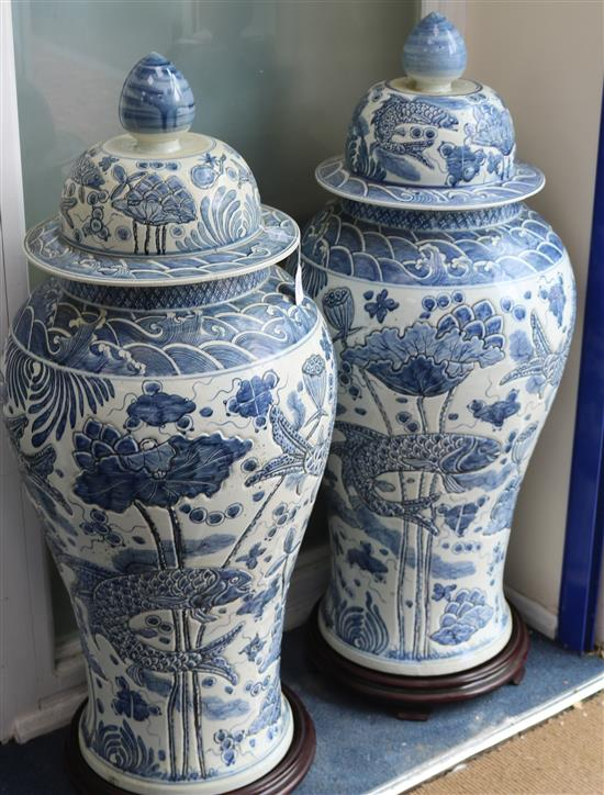 A pair of Chinese 20th century blue and white large floor vases and covers, H approx 118cm