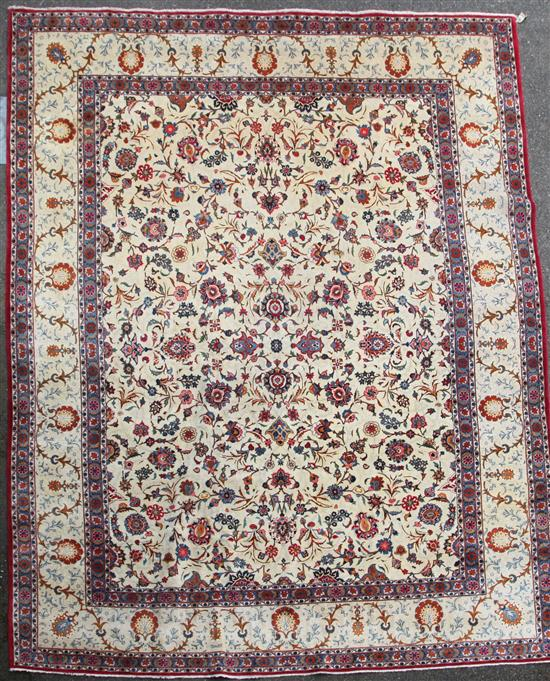 A Kashan ivory ground carpet, 14ft 3in by 10ft 7in.