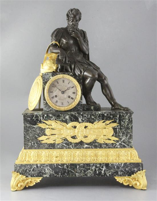 A second quarter of the 19th century gilt and patinated bronze mounted antico verdi marble mantel clock
