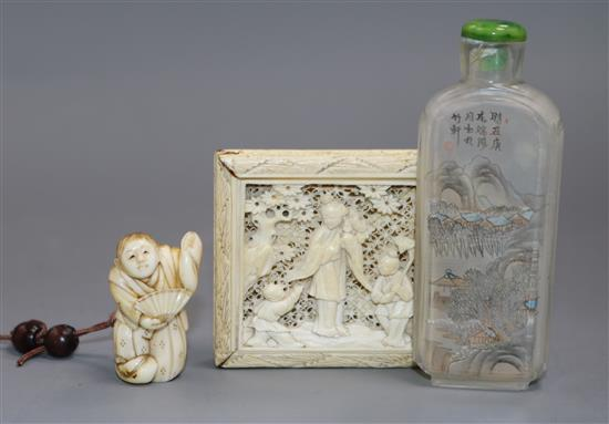 A Chinese ivory tangram puzzle, an ivory netsuke and a pressed amber rhino