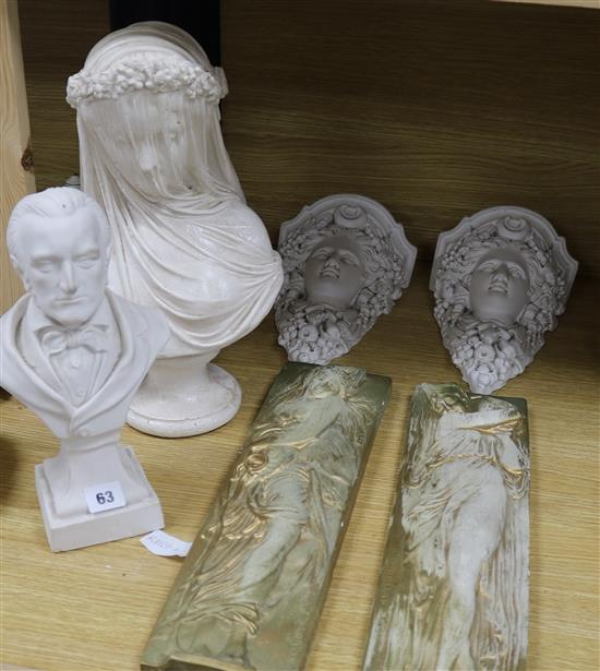 Two plaster busts, a pair of plaster wall shelves and two plaster reliefs
