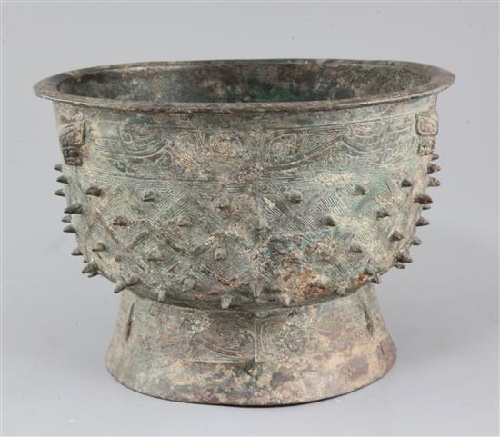 A Chinese archaic bronze ritual food vessel, Yu, Shang dynasty, Anyang type, 17cm high, 25.5cm diameter, crack