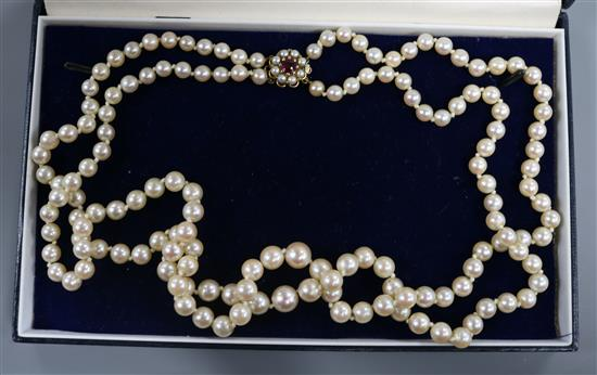 A double string graduated cultured pearl necklace with 9ct gold, pearl and gem set clasp, 52cm.