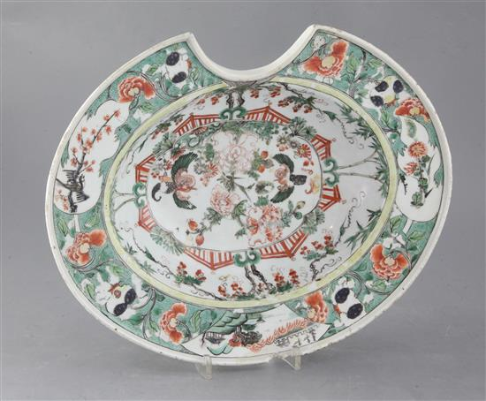 A Chinese export famille verte oval barbers bowl, Kangxi period, width 35.5cm, faults