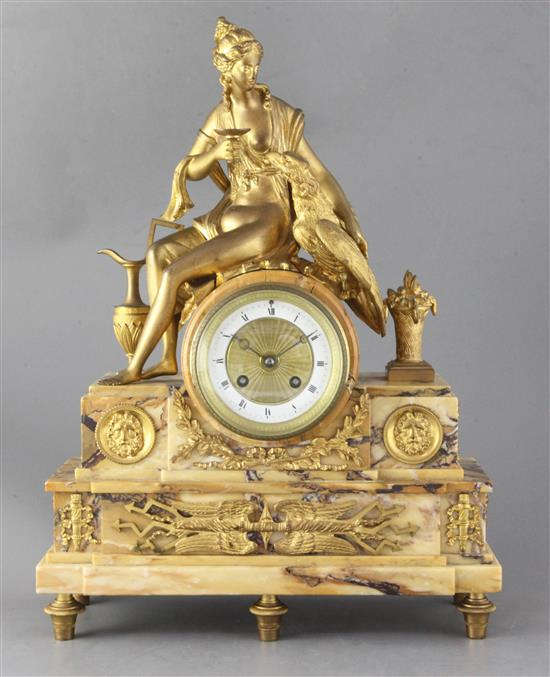 A 19th century French ormolu mounted Sienna marble mantel clock, height 17.75in.