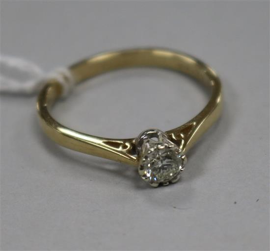 A modern 9ct gold and collet set solitaire diamond ring, size V.