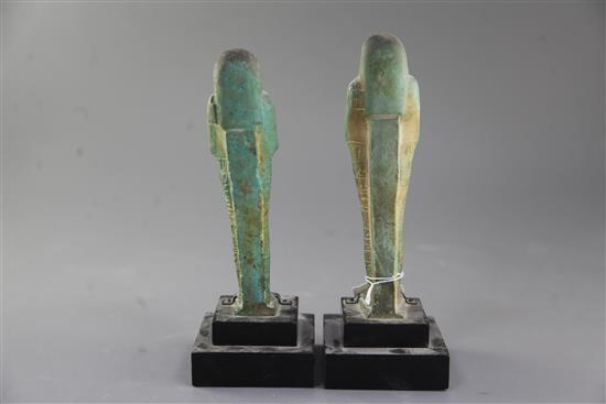 Two Egyptian green glazed composition Shabti, late period, 26th-30th dynasty, circa 664-332 B.C., 18.5 and 19cm excluding ebonised wood