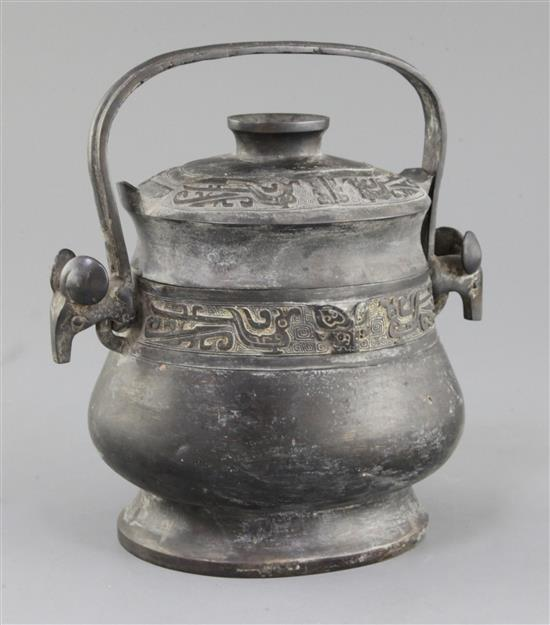 A Chinese archaic bronze ritual wine vessel and cover, You, late Shang/early Western Zhou dynasty, 11th century B.C., 22cm high, repair