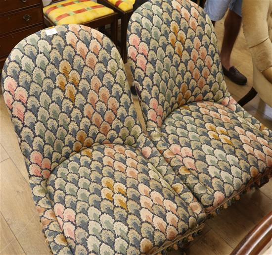 A pair of Victorian rosewood tapestry upholstered nursing chairs