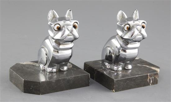 H. Moreau. A pair of Art Deco spelter bookends, modelled as a seated French Bulldog, height 4.25in.