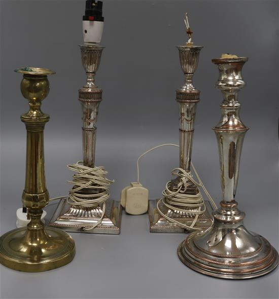 Four plated candlesticks, one fitted as a table lamp