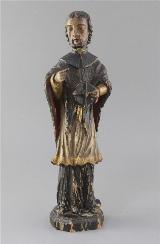 A 15th century German polychrome on wood figure of St. Nepomuk, 15in.