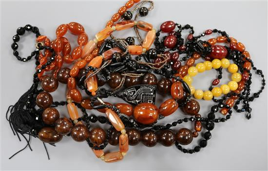 A quantity of assorted bead necklaces including agate and simulated amber etc.