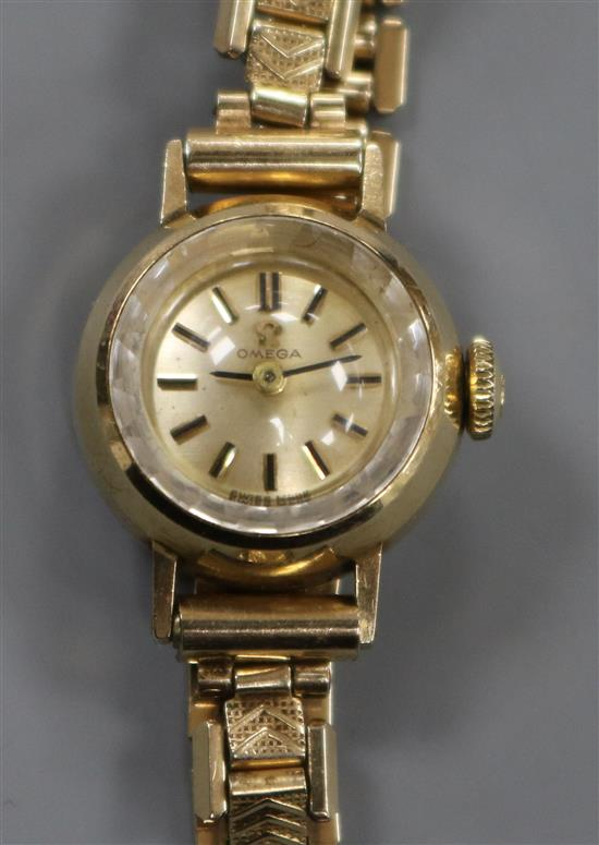 A ladys 9ct gold Omega manual wind wrist watch, on a steel and gold plated bracelet, with Omega box.
