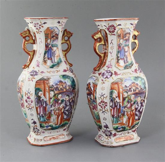A pair of Chinese famille rose Mandarin hexagonal baluster vases, Qianlong period, height 27.5cm, slight damage