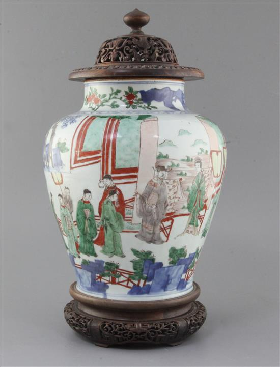 A Chinese wucai baluster jar, Transitional period, 17th century, height 28cm excl. carved hongmu stand and cover