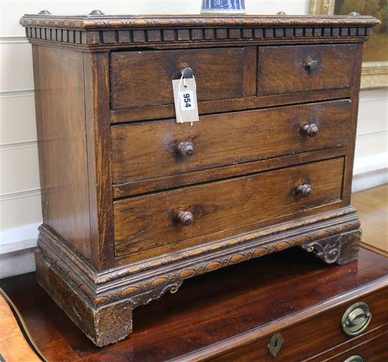 A North Italian walnut small chest of drawers W.65cm