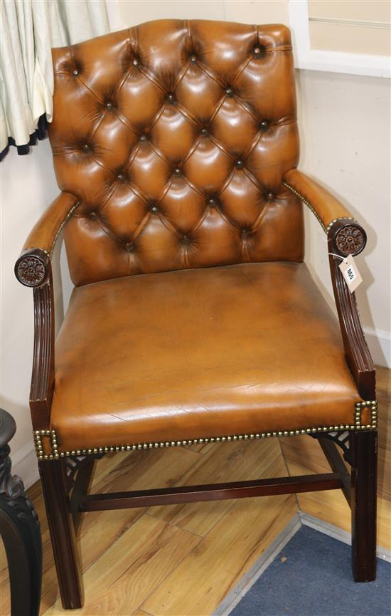 A mahogany framed leather button back Gainsborough armchair
