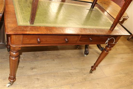 A Victorian mahogany two drawer writing table, with green leather inset top W.111cm