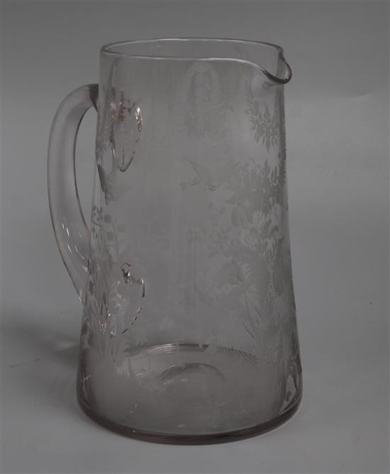 A Stourbridge glass jug engraved with birds, leafy swags and flowers height 20cm